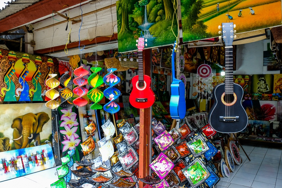 Guitars, paintings, and handmade souvenirs for sale in Ubud, Bali