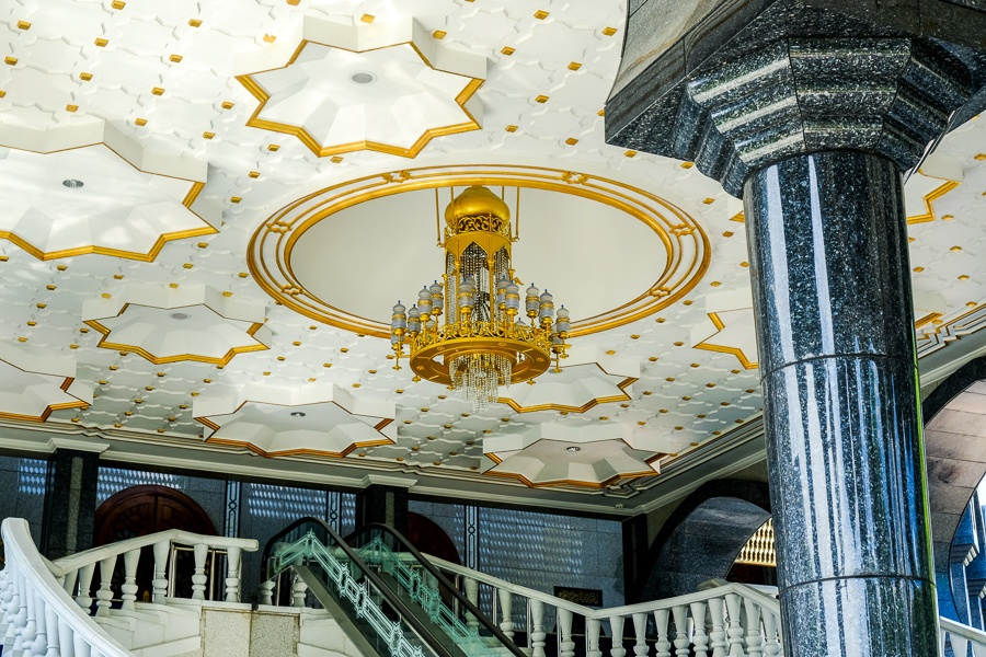 Stairways and gold chandelier at the Jame'Asr Hassanil Bolkiah mosque in Brunei