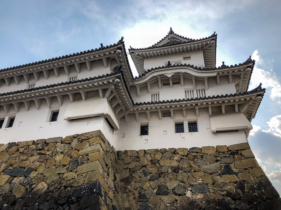 Sunlight behind a building at Himeji Castle in Japan