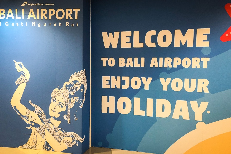 Welcome sign with a Balinese dancer at the Bali airport