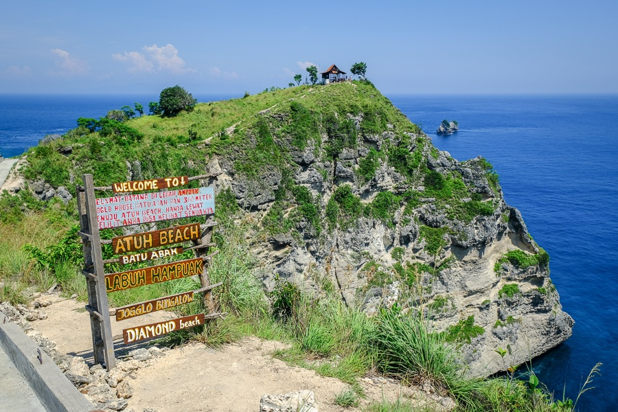 Welcome sign and Joglo Bungalow at Atuh Beach and Diamond Beach in Nusa Penida, Bali