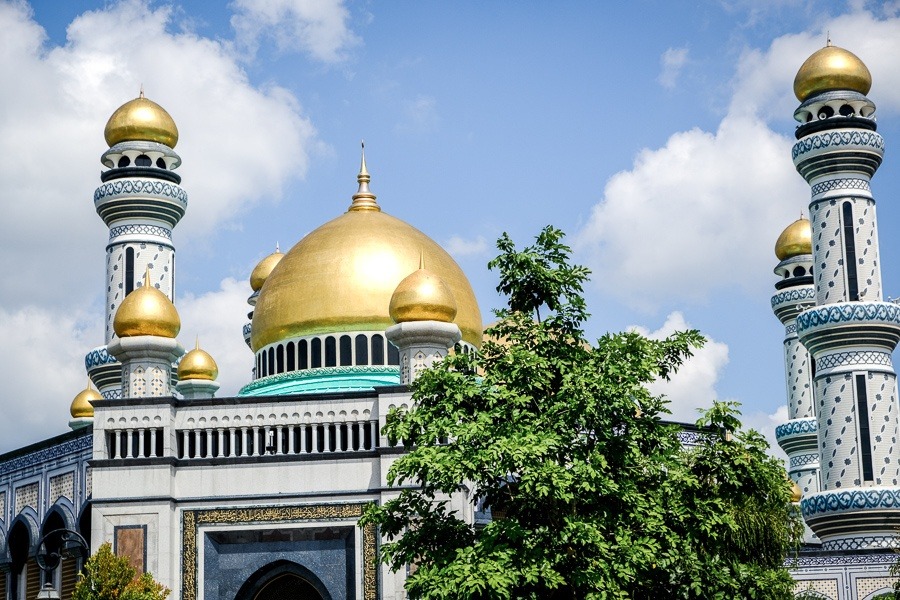 Trees and domes at the Jame'Asr Hassanil Bolkiah mosque in Brunei