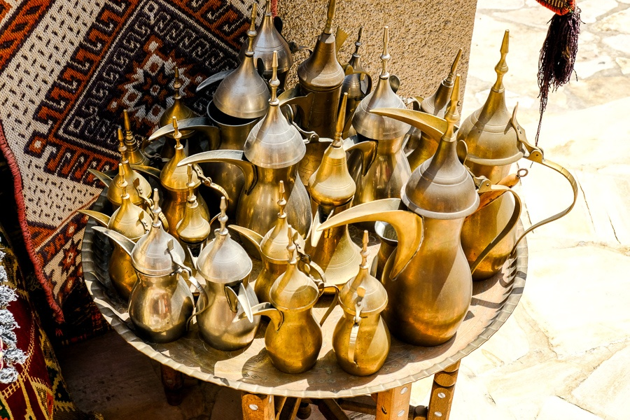 Arabic teapots for sale at a traditional market in Dubai, UAE
