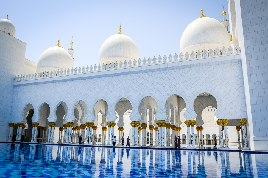Pool reflection and domes at the Sheikh Zayed Grand Mosque in Abu Dhabi, UAE