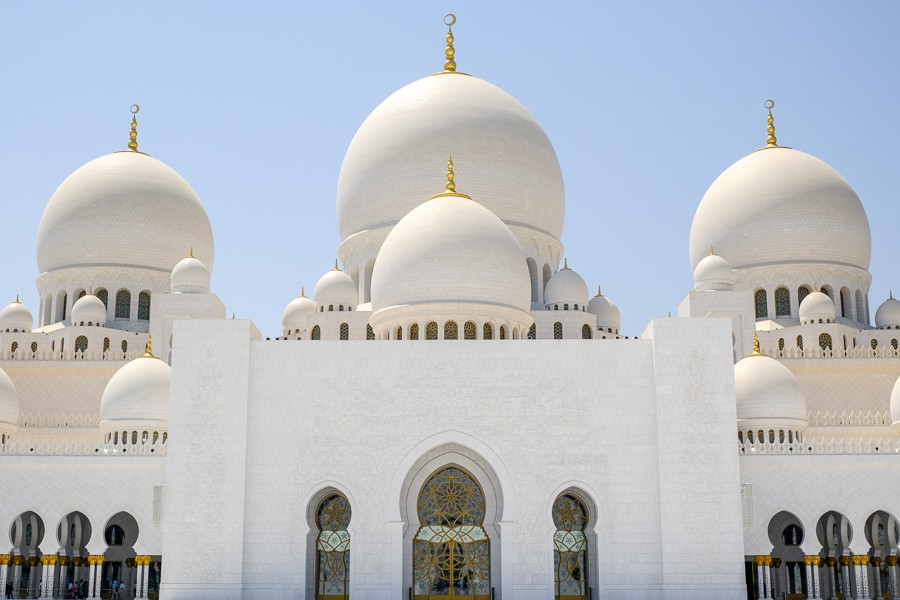 Front domes and doorways at the Sheikh Zayed Grand Mosque in Abu Dhabi, UAE