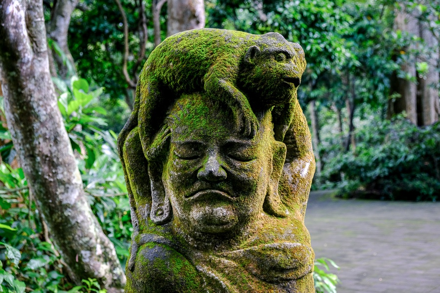 Mossy statue at the Ubud Monkey Forest in Bali