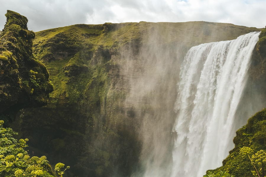 Up close view of troll head and Skogafoss Waterfall in Iceland