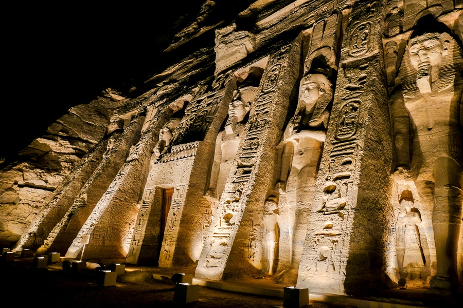 Queen's temple at Abu Simbel lit up at night in Egypt