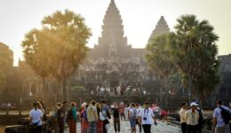 Tourists walking to the entrance at the Angkor Wat temple in Cambodia