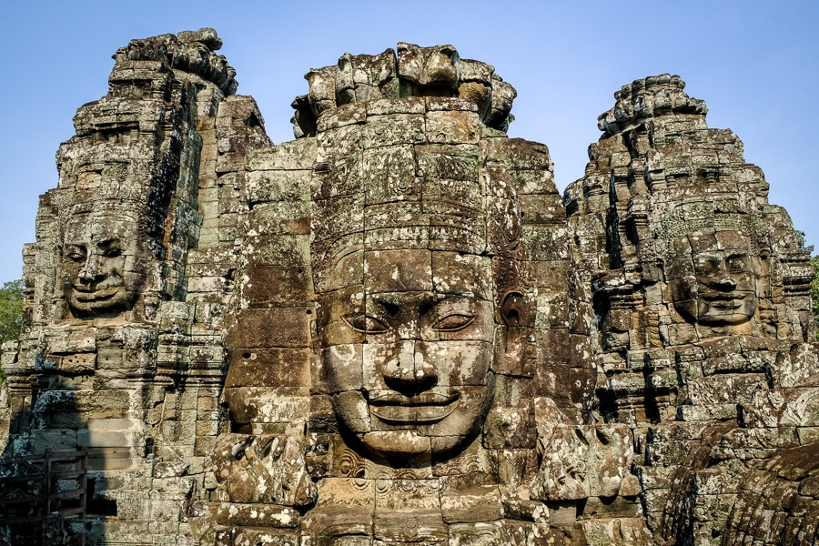 Giant stone faces at the Angkor Wat in Cambodia