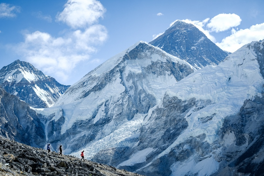 Hikers with Mt Everest on the Everest Base Camp Trek in Nepal
