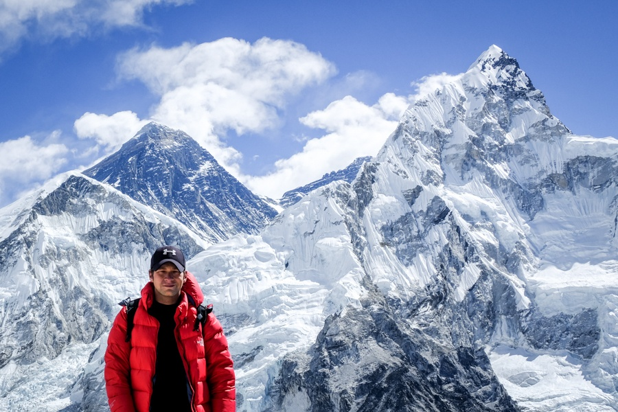 Travel guy with Mount Everest view from Kala Patthar on the Mt Everest Base Camp Trek in Nepal