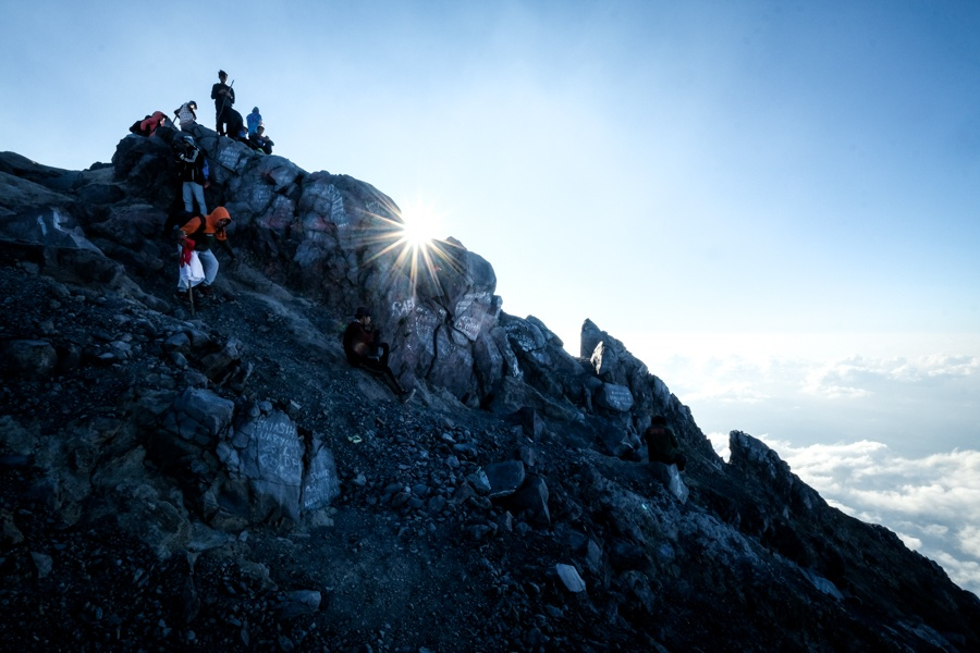 Hikers at the Mount Agung volcano crater in Bali