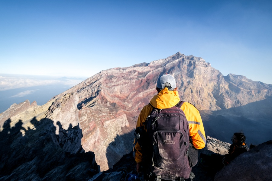 Hiker at the Mount Agung volcano crater in Bali
